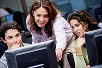 Woman Teaching in Computer Lab