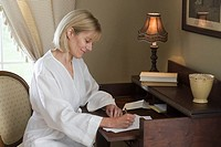 Woman in Dressing Gown Writing Letter