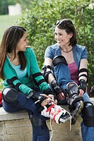 Young Women Putting on Inline Skates