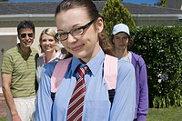 Smiling Teenage Girl with Family in Front of House (thumbnail)