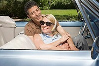 Happy Couple in Convertible (thumbnail)