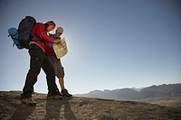 Two Hikers in Remote Area Looking at Map (thumbnail)