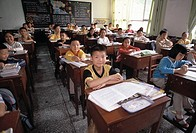 First grade class, children at desks, boy at center, elementary school, Chongqing, China, Asia, 041603