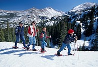 Family having fun while snowshoeing in Rocky Mtn Nat´l Park, CO