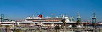 Wide view of the Queen mary 2 as she is docked at berth 87 in San Pedro harbor, Los Angeles, California