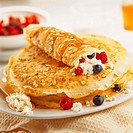 Crepes filled with fruit and cheese