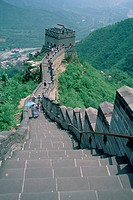 Hikers and tourists walking along the Great Wall of China in Badaling, China.