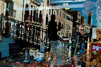 Reflection of buildings on the glass front of a store, Venice, Veneto, Italy