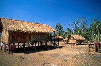 Thatched roof huts in a village, Thailand