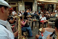 Musicians playing musical instruments at a sidewalk cafe, Provence, France
