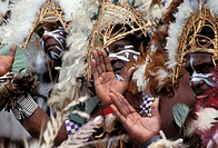 Solomon Islands, local men in traditional dress, feathers and face paint, clapping NO MODEL RELEASE