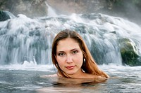 Young woman enjoying hot springs