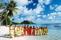 Traditional island dress of French Polynesians on Bora Bora beach in Society Islands