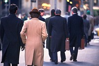 Business people walking down on street, rear view, New York City, NY, USA