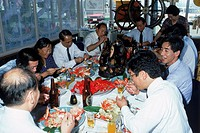 Business people eating fresh crab dinner and drinking beer at restaurant on Hokkaido Island in Japan