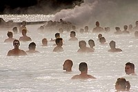 Bathers in the termal treatment center in Blue Lagoon, Iceland