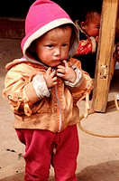 little boy of the Mosuo Minotity near the Lugu Lake. Yunnan. China