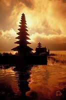 Ulun Danu Temple on Lake Bratan, Bali, Indonesia silhouetted against the sky.