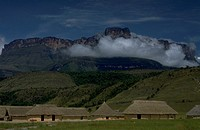 Auyan tepui mountain rises up above the Camp Kavak tourist village in Canaima National park, Venezuela.