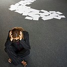 Frustrated Businesswomen and Trail of Index Cards