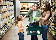 Mother and Daughters Shopping in Supermarket