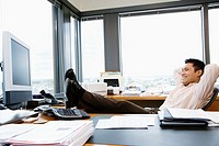 Businessman in Office Putting His Feet up