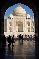 View of Taj Mahal through the Mosque gates.  Agra. Uttar Pradesh. India.
