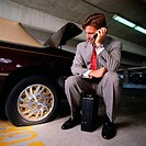 Businessman with Flat Tire