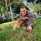 Man Picking Up Dog Feces