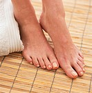 Woman's Bare Feet on Bamboo Mat