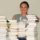 Woman Taking Inventory of Books