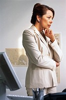 Businesswoman Thinking in Office