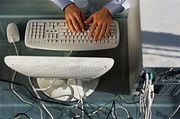 Man's Hands Using Keyboard