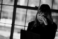 Worn-Out Businesswoman Closing Her Eyes