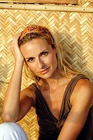 Portrait of beautiful blonde woman shot in an Indian beach hut