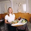 Waitress Posing with a Full Tray