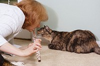 Woman in her 40´s playing flute and play the music for her cat, and the cat doesnt like it?