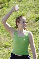 Teen girl/girl in early 20´s pour water down after a hard work out/run