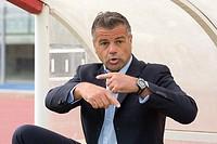 Man in suit signaling