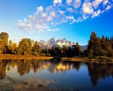 Lake Reflecting Forest and Mountains