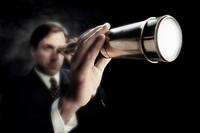 Businessman Holding a Telescope