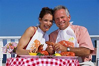 Couple Enjoying Lobster Lunch