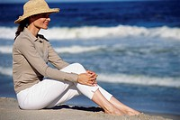 Woman Wearing Sun Hat at Beach