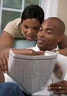 Husband and Wife Reading Stock Listings