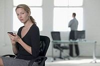 Businesswoman Using PDA in Office