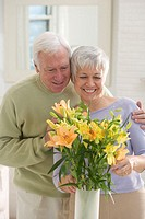 Senior Couple with Flower Arrangement