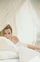 Woman, lie expectantly, bed, portrait,  Detail  Women portrait, young, 20-30 years, long-haired, beauty, attractiveness, gaze camera, seduction, expec...