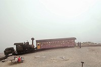 Tourists wait to ride on the cog wheel train on top of  Mount Washington Cog Railway. New Hampshire. USA