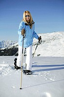 Winter landscape, woman, young, happy,  Snowshoe hiking, winters,  Leisure time, winter clothing, snowshoes, ski poles, locomotion means, snow, concep...