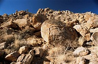 Weathered granite  Rounded granite boulders near Aus, Namibia  This type of weathering is known as spheroidal weathering, a type of chemical weatherin...